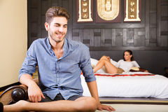 A young couple on vacations enjoying their Hotel room Stock Photos