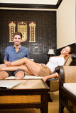 A young couple on vacations enjoying their Hotel room. A young and happy couple on holidays enjoying their hotel room Stock Photo