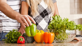 Young Couple with Vegetables Royalty Free Stock Photo