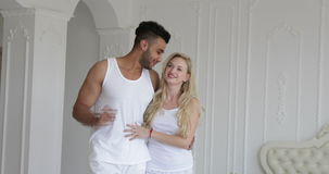 Young couple viewing beautiful modern apartment mixed race man woman Stock Photo