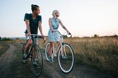 Young couple on vintage bikes Stock Photos