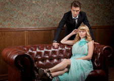 Young couple in vintage interior in retro style Stock Photo