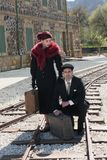 Young couple with vintage suitcase on the trainlines ready for a Stock Photo