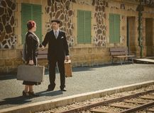 Young couple with vintage suitcases on the train station Royalty Free Stock Photography