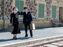 Young couple with vintage suitcases on the train station Stock Image