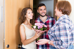 Young couple visited  elderly mother. At parent home Stock Photo