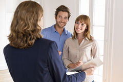 Young couple visiting apartment with real estate agent Royalty Free Stock Image