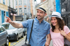 Young couple visiting city during holidays Stock Images