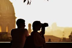 Young couple visiting rome. Tourism in Europe, photography. Summer, sunset city royalty free stock photos