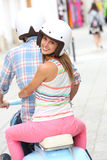 Young couple visiting town with motorcycle Stock Images