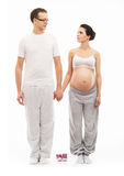 Young couple waiting for the baby isolated on white Stock Photography