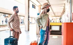 Free Young Couple Waiting In Line Practising Social Distancing At Train Station - New Normal Travel Concept With People With Face Mask Royalty Free Stock Photo - 195071965