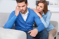 Young couple waiting for psychology session family problems girlfriend leaning on boyfriend. Young couple men and women waiting for psychology session sitting on Royalty Free Stock Photo