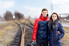 Young couple waiting on the railway tracks Stock Photography