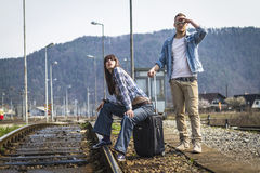 Young couple waiting for the train Royalty Free Stock Images