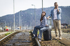 Young couple waiting for the train Royalty Free Stock Photography