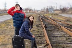 Young couple waiting for a train Royalty Free Stock Photos