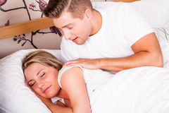 Young couple waking up Royalty Free Stock Photography