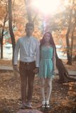 Young couple on a walk in autumn park Royalty Free Stock Image