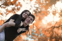 Young couple on a walk in autumn park Royalty Free Stock Photography
