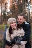 Girl with guy in autumn park. Young couple on walk in autumn park stock images