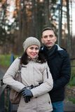 Young girl with guy in autumn park. Young couple on walk in autumn park stock image