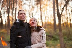Young couple on walk in autumn park. Portrait of women and men on walk in autumn forest stock image