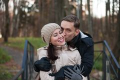 Young couple on walk in autumn park. Portrait of women and men on walk in autumn forest stock photos