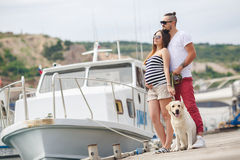 Young couple on a walk in the Harbor with a dog Stock Photo