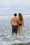 Young Couple Walk In the Ocean Stock Images