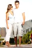 Young couple on a walk in the park Stock Images