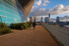 Young couple walk in Queen Elizabeth Olympic Park royalty free stock photography