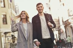 Young couple walk at the street on sunny day stock image