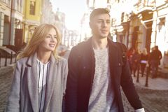 Beautiful couple walking at street. Young couple walk at the street together on sunny day Royalty Free Stock Photos