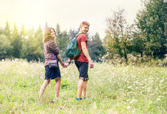 Young couple on the walk in summer forest Stock Photo
