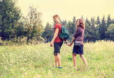 Young couple on the walk in summer forest Stock Images