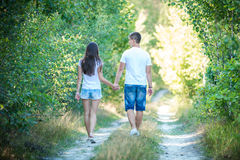 Young couple on walk in summer forest Royalty Free Stock Photo