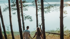 Young Couple Walk To River Bank stock footage