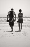 Young Couple Walking Across Beach Stock Photography