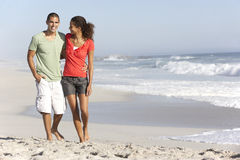 Young Couple Walking Along Beach Stock Photography