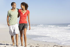 Young Couple Walking Along Beach Royalty Free Stock Image
