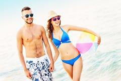 Young couple walking along the beach Stock Photos