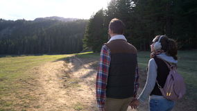 Young couple walking along the lake stock video footage