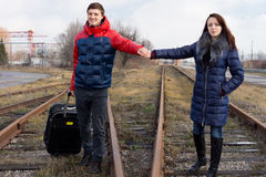 Young couple walking along a railway line Stock Photos