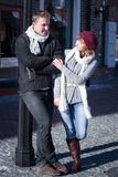 Young Couple Walking Around City In Winter. Stock Images