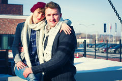 Young couple walking around city in winter. royalty free stock image