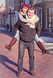 Young couple walking around city in winter. Stock Photos