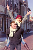 Young couple walking around city in winter. Royalty Free Stock Images