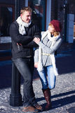 Young couple walking around city in winter. Stock Photo