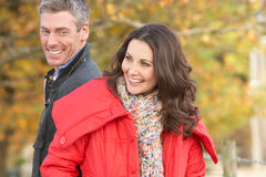 Young Couple Walking Through Autumn Park Royalty Free Stock Image